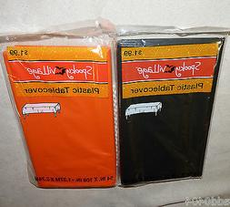 "2 HALLOWEEN plastic table covers - orange and black - 54"" X"