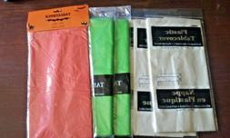"""Lot plastic table covers 54"""" x 108"""" NWT ivory, orange, green"""